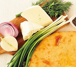 Осетинский пирог с сыром, капустой и зеленым луком